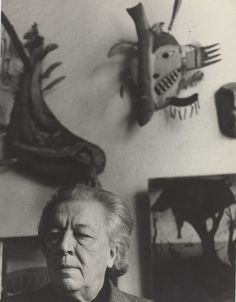 Andre Breton in his studio with Masks in the background / Photograph Lütfi Özkök, vers 1963