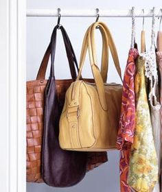 Use Shower Curtain Hooks: If space allows, place hooks on a closet bar and hang purses from them to keep your carryalls at eye level. Say good-bye to a mess of accessories on your closet floor.
