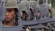 Colombian soldiers march in formation at Tres Esquinas, a military base deep in Colombias coca-growing Amazonian lowlands, on Wednesday, July 5, 2000