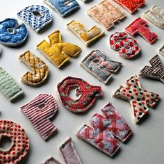 sew alphabet letters- hot glue magnets on back