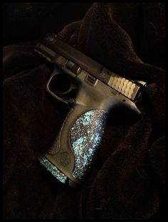 Bada Bling, Bada Boom:  My new Smith & Wesson M & P 9mm;  Bling additions from www.gungoddess.com (there's a Swarovski crystal on the slide cover plate, too, but you can't see it here.