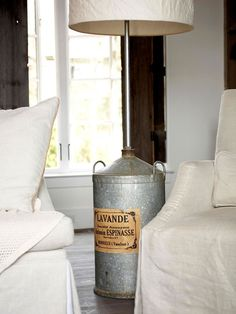 Repurpose flea market finds like this French lavender storage container that acts as the base for a floor lamp. More flea market home accents: http://www.bhg.com/decorating/decorating-style/flea-market/flea-market-chic-home-accents/?socsrc=bhgpin070613lamp=17