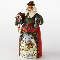 Jim Shore® German Santa  Smithsonianstore.org  This Jim Shore German Santa is a Folk art interpretation of an Alpine Bavarian.  Re-imagined as a jolly Father Christmas, this German Santa wears his traditional lederhosen, displaying an idyllic mountain scene and holds a cuckoo clock and a lidded beer stein.  Hand-painted stone resin.  6.75 inches high.