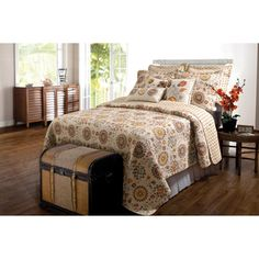 @Overstock.com - Andorra 3-piece Quilt Set - Moon-shaped medallions and floral crests adorn this retro style quilt set that reverses to an all-over foulard print. The set is machine quilted for durability and oversized for better coverage on today's deeper mattresses.  http://www.overstock.com/Bedding-Bath/Andorra-3-piece-Quilt-Set/8102949/product.html?CID=214117 $71.99