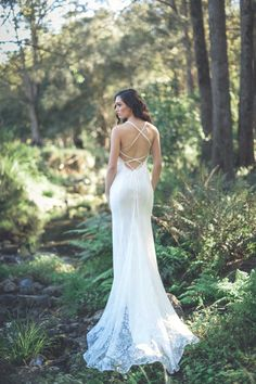 Our ANGELINA Bridal Gown is made with premium floral lace and a jersey satin stretch lining. Lace up straps hug the back and tie just above the hips while it's skirt extends into a one metre train. See more here: http://goddessbynature.com/product/angelina-lace-mermaid-gown-bridal/