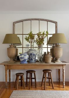 Console table with paneled arched mirror