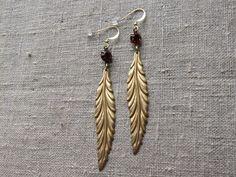 Earrings / Øreringe. Long dangle earrings made of brass and dark red glass. www.bulowssmykker55.amioamio.com