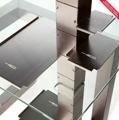 """Writing desk   Console. The tubular structure in brushed stainless steel overhangs the top glass tray. The uncluttered and minimalist design of the """"BOOTH Table"""", up to the slightest detail, transcends the functional aestheticism in vector of emotion."""