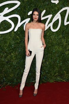 Kendall Jenner wears a sleek white jumpsuit with black panels to the British Fashion Awards in London.