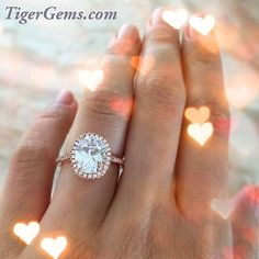 The 3.25 oval halo ring custom plated in 14k rose gold. 😍 💍 Please contact me when you place your order if you would like to add that the rose color. It will take a few days for custom plating  Shop now at 💍✨ TigerGems.com  #handmade #hearts #diamondring #weddingset #manmadediamond #proposal #love #engagementring