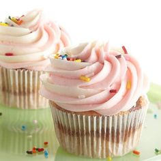 Neapolitan Cupcakes -  Layers of strawberry, chocolate, and vanilla bake into a delightful confection. Top with a swirl of ice cream frosting for an irresistible finish.
