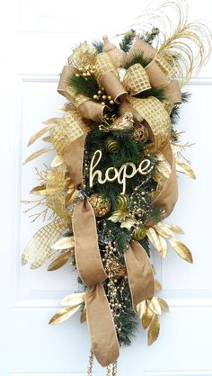 """Gold Christmas and Winter Swag with gold beaded garland and """"HOPE"""" sign covered in rhinestones."""