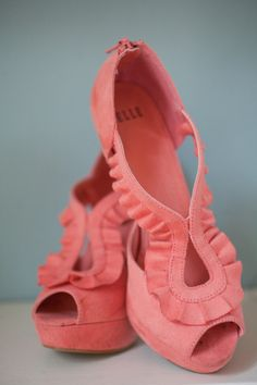 Coral ruffle pumps.