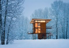 """THE DELTA SHELTER, BY OLSON KUNDIG, MAZAMA, WASHINGTON Because its site floods seasonally, the 305-square-foot Delta Shelter had to be raised up on stilts, giving it an exotic look and impressive views from the upper windows. """"When it is closed up, the cabin stands like a sentry in the aspen forest,"""" architect Olson Kundig says."""