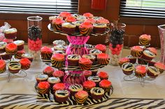 candy bar Part 1 for zebra print and hot pink baby shower coordinated by Me.  I made the cupcake stand with cake boards, wrapping paper, and bowls.
