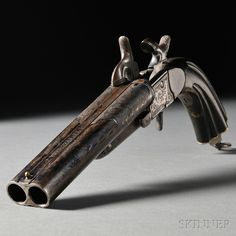 Spanish Double Barrel Pistol, c. 1878, dark stained walnut grips with engraved frame and barrels, marked on top of the barrel JOSIE GARCIA ARMERO DE LA REAL CASA. GRANADA ANO 1878, barrel lg. 5 1/2, overall lg. 11 in. Estimate $900-1,100