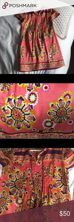 Trina Turk silk dress Trina Turk sundress. Fit is loose. Fabric is beautiful - pinks, purples, yellows in a floral-ish ikat-ish print - in impeccable shape. Short sleeves, purple tassels down the front add a subtle bit of style.  Worn once. Trina Turk Dresses Mini