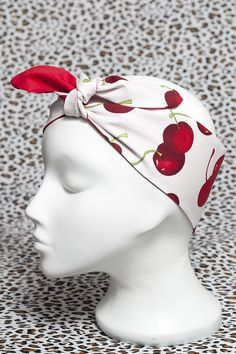 White and red cherry head scarf.  http://bad-kitty.co.uk/product/red-cherry-head-scarf/  Pretty hand made Bad Kitty vintage style 50′s rockabilly roller derby white and red cherry cotton fabric head scarf with a plain red reverse.