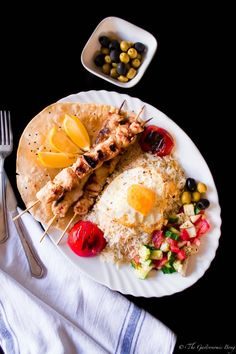 Persian Joojeh Kebab on a bed of Chelo, Fried Egg and Shirazi Salad | The Gastronomic BONG