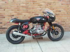 Like the red frame, black wheels and black pipes.