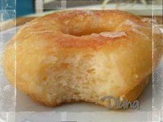 DONUTS SIN GLUTEN - 80 g mantequilla en pomada - 100 g de azúcar - 100 g de harina de arroz - 150 g de harina Mix B Schär - 2 huevos - 200 ml de nata de cocinar - 2 cucharadas de postre de levadura seca - 1 cucharada de vainilla - Unas semillas de cardamomo molidas - Ralladura de naranja
