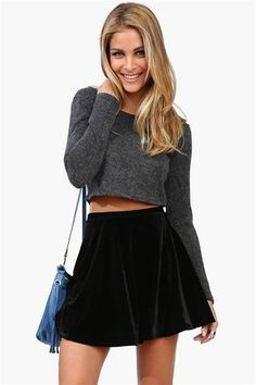 Adorable casual party outfit idea. Black velvet skater skirt, grey cropped sweater, bag. Neutral but classy and cute pop of colour color blue or colorful colourful purse