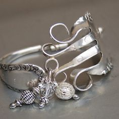 Fork bracelet with charms