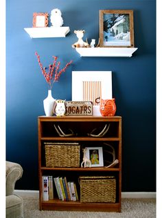 open bookcase and decor on top and on wall above.