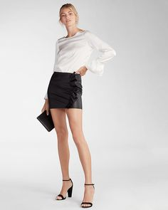 Elegance with an edge. Make an impression in this sleek and sexy faux leather skirt featuring stylish ruffles and flirty mini length. Just add heels for an irresistibly leggy look.