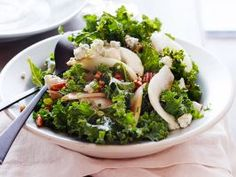 Winter Kale Salad : Melissa uses seasonal ingredients, like kale, toasted pecans, sweet pear and blue cheese, to create a fresh and inexpensive salad for the holidays. The rustic flavors here will pair well with just about any main dish.