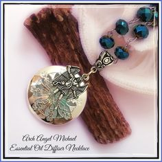 "Essential Oil Diffuser Necklace Archangel Michael Carry Your Essential Oils (Aromatherapy)Anywhere. Beautiful Necklace with ArchAngel Michael. Michael lends you protection, courage and confidence. He is the Angel that represents the all encompassing strength of the divine. Necklace is 28-1/2"" long and the diffuser is 1-1/4"" round. Comes with 4 felt pads to apply oils. I often wear this at night with lavender oil to help me sleep and to remind me that Archangel Michael is always available to…"