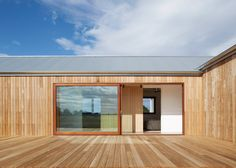 Corrugated steel provides durable facade for house by Glow Design Group Contemporary Cottage, Contemporary Bedroom, Contemporary Building, Contemporary Apartment, Contemporary Office, Contemporary Chandelier, Contemporary Landscape, Contemporary Architecture, Contemporary Furniture