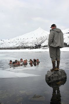 An instructor monitors SEAL candidates while they were completing the re-warming exercise after spending 48 hours in the Alaskan mountains learning how to navigate through the rugged terrain and survive the frigid conditions. The 28-day cold-weather training course, taught in Kodiak, is part of a yearlong process to become a U.S. Navy SEAL.