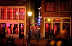 Amsterdam Red Light District - Windows by RudmerHK, via Flickr- to me, there is such sadness attached to women dancing behind these windows...