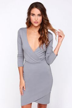 LuLu*s Exclusive! With just a little help from the Lean Into It Grey Dress, you'll have a million dollar look in your own signature style! The V neckline and darted wrap bodice give this dress a flattering silhouette, helped along by the stretch knit. An elastic waist tops the bodycon skirt below, which ends with an uneven hem. Hidden back zipper. Unlined. 65% Rayon, 30% Nylon, 5% Spandex. Hand Wash Cold, Or Dry Clean. Made With Love in the U.S.A.