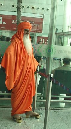 Golden shod materially spiritual sadhu at Delhi airport