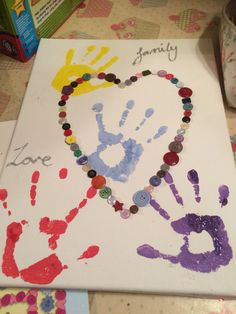 Hand print picture made by my 2 children as a gift for their granny. It's made in a canvas brought from the 99p shop