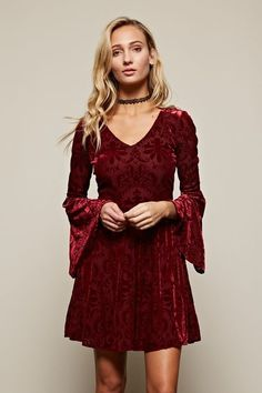Winter wonder night cannot get better without a long sleeve Velvet dress in the perfect holiday color - burgundy. This dress is stunning! Calls out the gorgeous total babe in you. Features long bell s