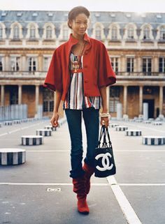 red cape jacket w/ 3/4 sleeves + multi-color striped blouse + black & white Chanel bag