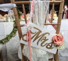 Mrs. sign for back of bride's chair. Painted wood, handmade paper roses with material and lace straps to finish it off.