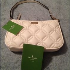 NWT Kate Spade handbag NWT cream color quilted pattern Kate Spade small handbag with care card. Has 3 credit card pockets inside kate spade Bags