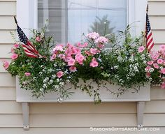 nantucket window boxes | How about small stakes and/or inverted bottles on stakes?
