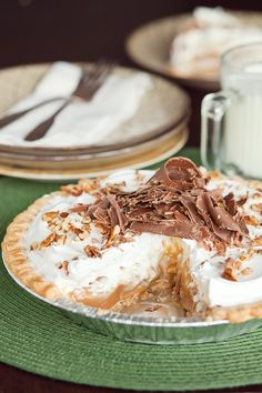 Caramel Pie Recipe ~ thick, gooey caramel filling, layered with mounds of airy whipped cream and topped with crunchy pecans and chocolate curls... Recipe from the May/June issue of Louisiana Cooking