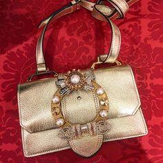 Strike gold: jeweled @miumiu handbag. Shop now on the Main Floor. #MiuMiu
