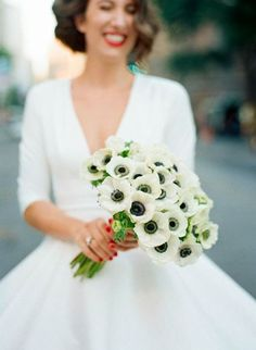 An all-white anemone wedding bouquet | Brides.com