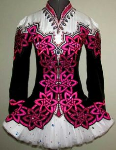 Cool color combination. A contemporary with minimal traditional that I do like, but don't love. Nice deep but bright pink - definitely my favorite kind. A little too standard with the knotwork - it could be more varied and interesting. Skirt style is nice but not my favorite.