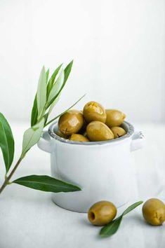 Glistening Olives on white background. Food Photography