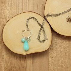 Sterling silver ring with aqua quartz, blue jade and a peruvian opal drop pendant necklace. Silver plate over brass chain, measuring 26″. Handmade in Portland, Oregon.