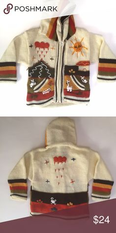 HANDMADE PERUVIAN SWEATER-2T HANDMADE PERUVIAN SWEATER-Size 2T. NWOT-a few loose threads in the design (fairly normal with handmade items). All profits from sale of this item are donated to hungry Peruvian families. Shirts & Tops Sweaters