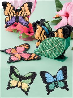 Rain Forest Coasters Plastic Canvas Pattern Download from e-PatternsCentral.com -- Four pretty butterfly patterns are yours in this delightful coaster set.